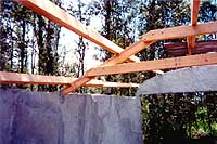 [detail - truss bolting and metal bracket connecting truss to wall]