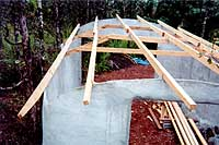 [view from above left rear of partially completed roof framing]